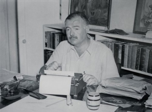 Ernest Hemingway appears sitting in front of his typewriter Cuba in the late 1940s