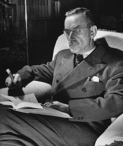 Thomas Mann reading a book at home. 1939